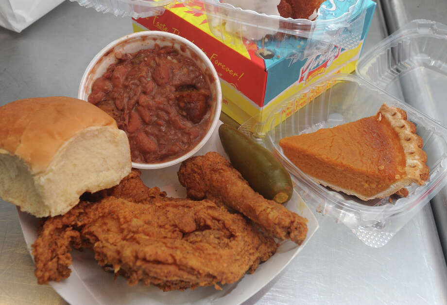 A three-piece meal served with beans and rice at Frenchy's Chicken Photo: Guiseppe Barranco/The Enterprise