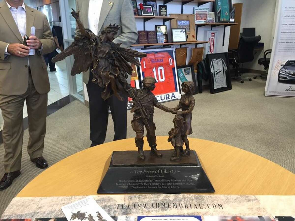 A replica of the Texas War Memorial statue sits at Gillman Acura. Dealership president Chris Gillman received the replica Wednesday during a ceremony to honor fallen troops. A 20-foot-tall version of the statue will rest at the Texas War Memorial, a monument to 225,000 Texas military members who've served in the War on Terror. The actual statue will be unveiled on the grounds of the state capitol in 2017.