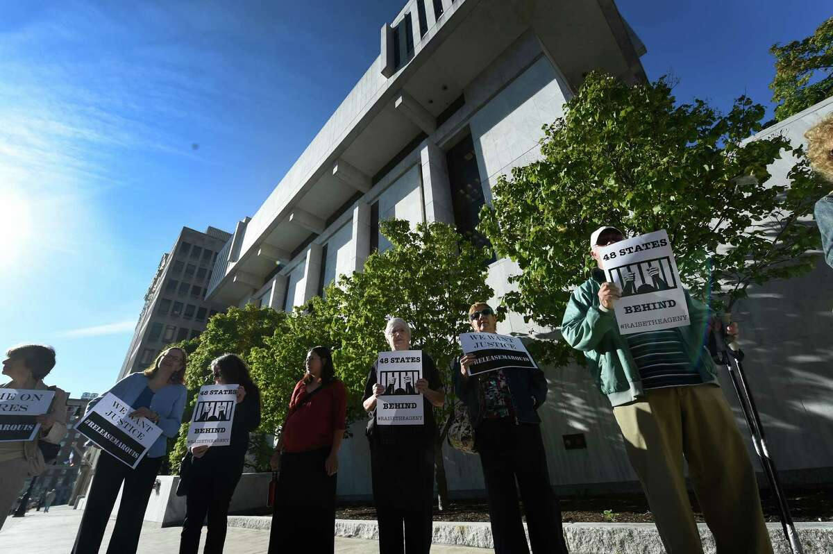 Demonstrators show their support for Marquis Dixon outside the Justice Building where his case is being argued in the Appellate Division Court on Friday, Sept. 16, 2016, in Albany, N.Y. (Skip Dickstein/Times Union)