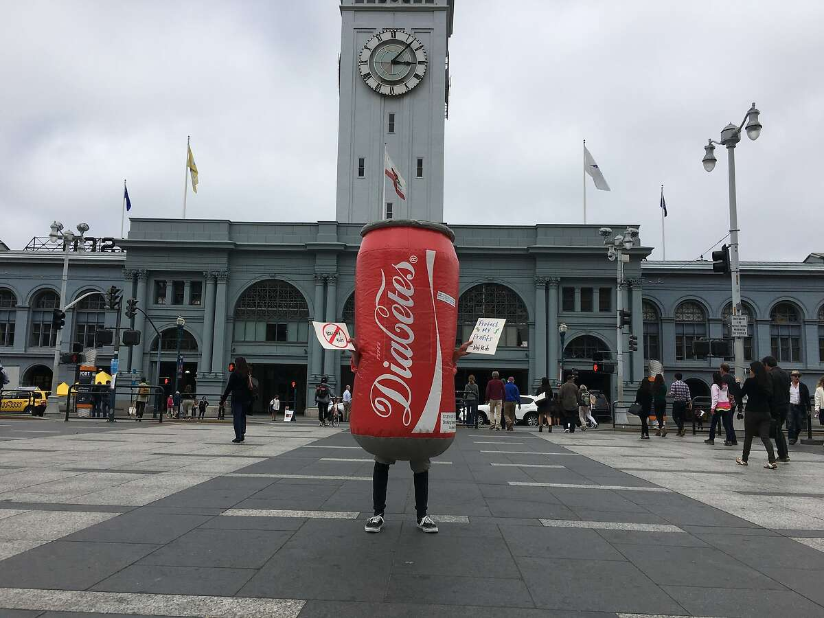 Sammy Soda, a mascot who�s appearing around town dressed as a giant red Coke can but with the word �Diabetes� written in the same curly font as Coca-Cola.