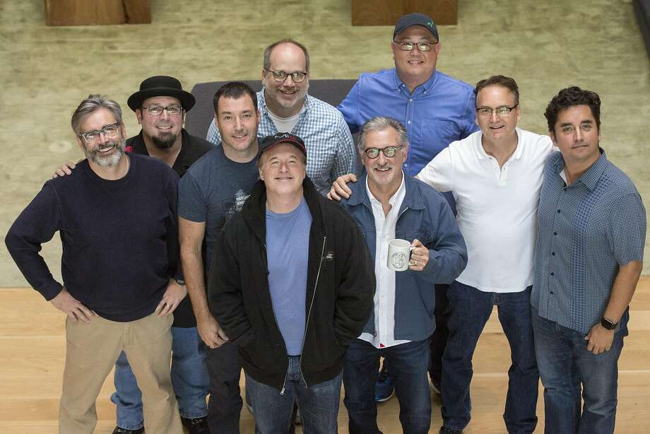 "Starting from left to right and top to bottom: Kevin O'Brien, Adam Burke, Mark Andrews, Tony Fucile, Brad Bird, Peter Sohn, John Walker, Jeffrey Lynch and Andrew Jimenez, at Pixar Animation Studios. The group worked on ""The Iron Giant"" (1999). Photo: Santiago Mejia, Special To The Chronicle"