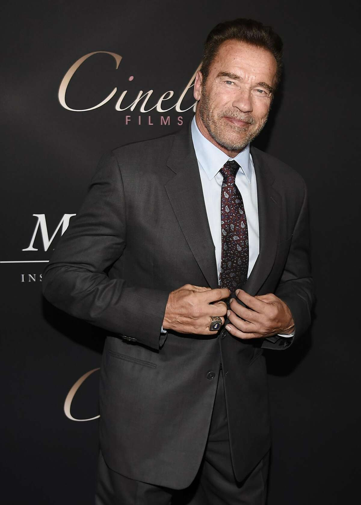 """Arnold Schwarzenegger poses at the premiere of the film """"Mr. Church"""" at the ArcLight Hollywood on Tuesday, Sept. 6, 2016, in Los Angeles. (Photo by Chris Pizzello/Invision/AP)"""