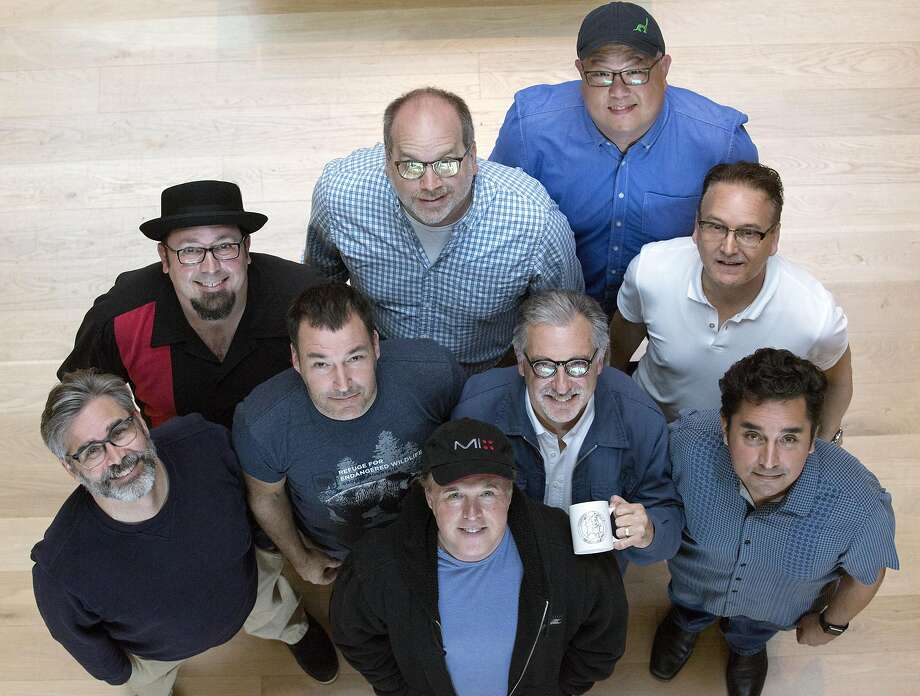 """Iron Giant"" vets, clockwise from left: Kevin O'Brien, Adam Burke, Tony Fucile, Peter Sohn, Jeffrey Lynch, Andrew Jimenez, John Walker (holding cup), Brad Bird and Mark Andrews. Photo: Santiago Mejia, Special To The Chronicle"