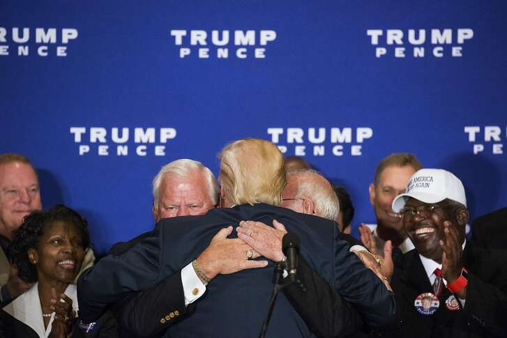 Donald Trump, the Republican presidential nominee, embraces attendees during a campaign event where he hosted Medal of Honor recipients, at the recently opened Trump International Hotel, in Washington, Sept. 16, 2016. Trump publicly retreated from his �birther� campaign on Friday, acknowledging that President Obama was born in the U.S. and saying that he wanted to move on from the conspiracy theory that he has been clinging to for years. (Damon Winter/The New York Times)