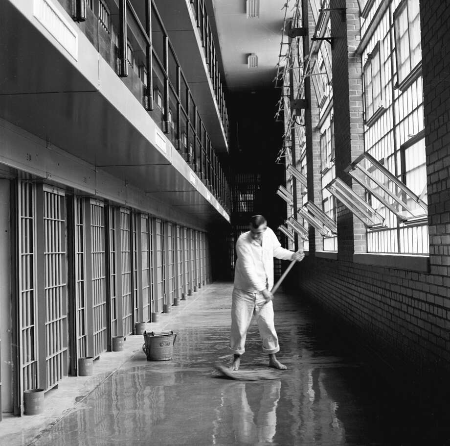 Ferguson Unit, inmate mopping floor, barefoot Photo: Jenevieve Andersen