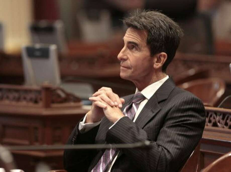 State Sen. Mark Leno, D-San Francisco, chair of the Senate budget committee, watches as the votes approving a measure to devote money found in a hidden state Department of Parks and Recreation special fund, be used to keep parks open, are posted at the Capitol Thursday, Aug. 30, 2012, in Sacramento, Calif.   The bill, AB1478,  will devote $20 million, which came from a special fund paid for with parks and recreation fees, to fund state parks and impose a two-year moratorium on any park closures,  was approved by a 25-12 vote and sent to the Assembly for final consideration.(AP Photo/Rich Pedroncelli) Photo: Rich Pedroncelli, Associated Press