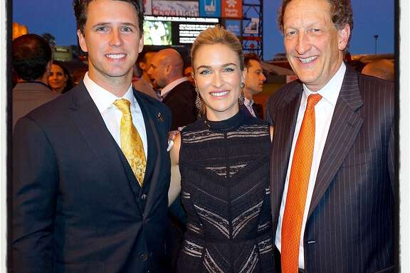 SF Giants MVP catcher Buster Posey (left) with his wife, Kristen Posey and Giants CEO-President Larry Baer at the ballpark for the Posey's inaugural pediatric cancer fundraiser. Sept 2016.