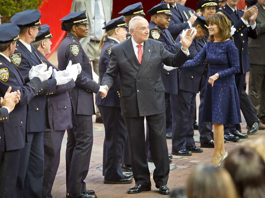 New York Police Department Commissioner William Bratton and his wife Rikki Klieman shake hands with officers during his retirement ceremony. Photo: Bebeto Matthews, Associated Press