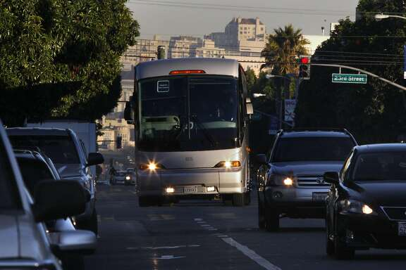 An Apple bus on Valencia at 24th streets in San Francisco, Calif., heads to Ridgeview main campus on Wednesday, January 22, 2014.