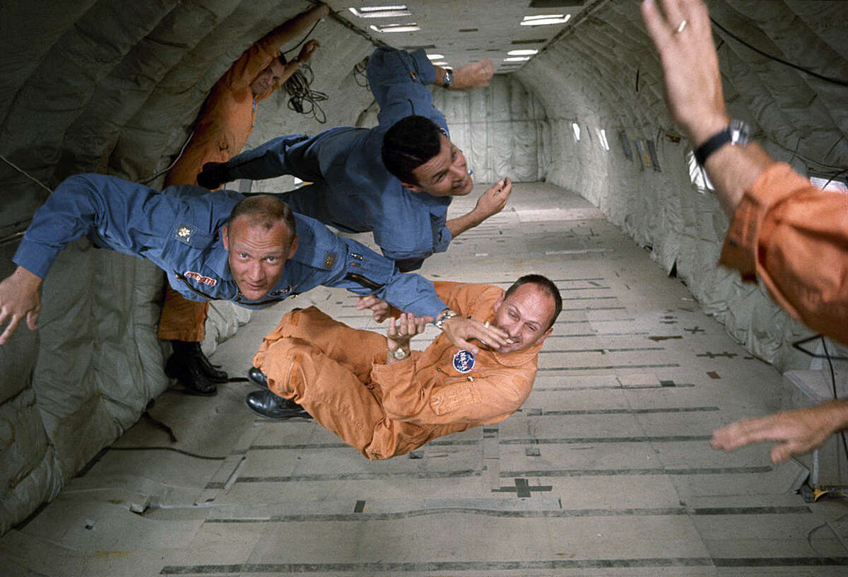 American astronauts, Buzz Aldrin (left, in blue), Charles Bassett (1931 - 1966) (top, in blue), and Theodore Freeman (1930 - 1964) (bottom, in orange), along with several technicians, experience weightlessness in a reduced gravity aircraft (probably a converted KC-135 Stratotanker) as part of their NASA mission training, 1964. (Photo by Ralph Morse/The LIFE Picture Collection/Getty Images)