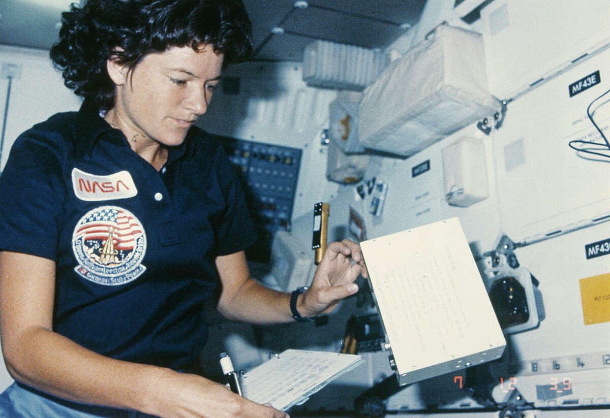 NASA astronaut Sally Ride in the interior of the Challenger space shuttle during the STS-41-G mission, October 1984. In 1983 she became the first American woman in space on the STS-7 mission. (Photo by Space Frontiers/Getty Images)
