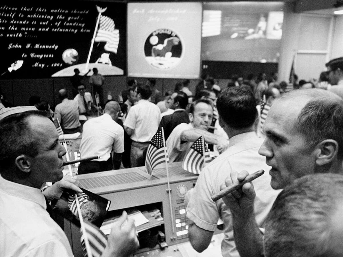 24th July 1969: The Mission Operations Control Room in the Mission Control Center, Building 30 of NASA's Manned Spacecraft Center in Houston, Texas. The flight controllers are celebrating the successful return of the Apollo 11 lunar landing crew. (Photo by NASA/Space Frontiers/Getty Images)