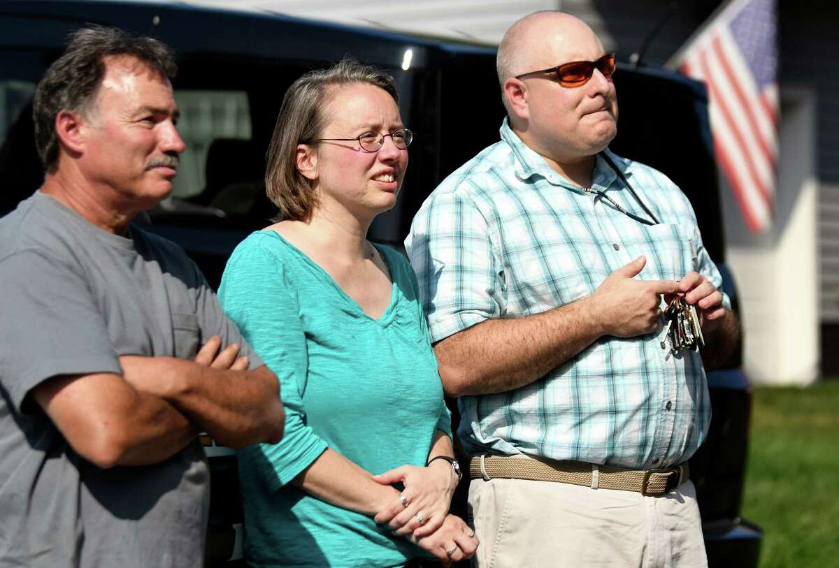 Neighbors watch the fire at 9 Sebring Ave. on Friday, Sept. 16, 2016, in Colonie, N.Y. From left are Glen Boni, Karen Cardone and her husband Anthony Cardone. (Cindy Schultz / Times Union)