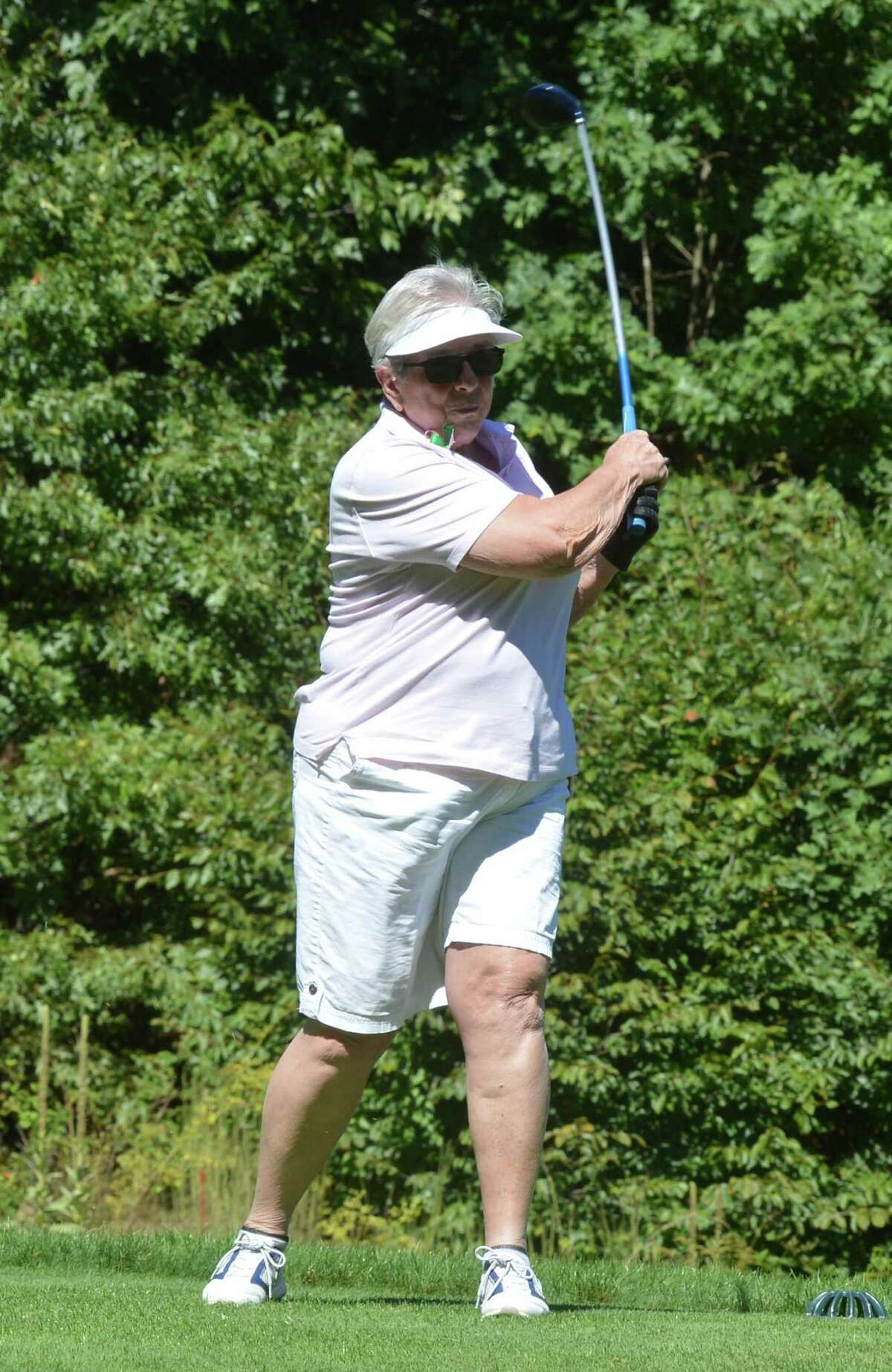 Michael Ness' grandmother Janet Hanna hits off the tee on the 2nd hole during 3rd annual Michael Ness Golf Tournament at Oak Hills Park in Norwalk Conn. on Monday September 12, 2016. The charity event benefits the Connecticut Burn Center at Bridgeport Hospital where Michael was treated for burns he suffered in a Norwalk house fire in 2013.