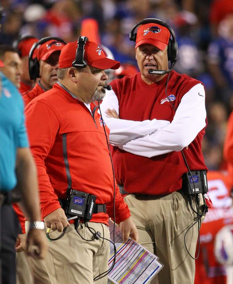 Bills offensive coordinator Greg Roman (left) was fired by head coach Rex Ryan (right). Photo: Bill Wippert, Associated Press