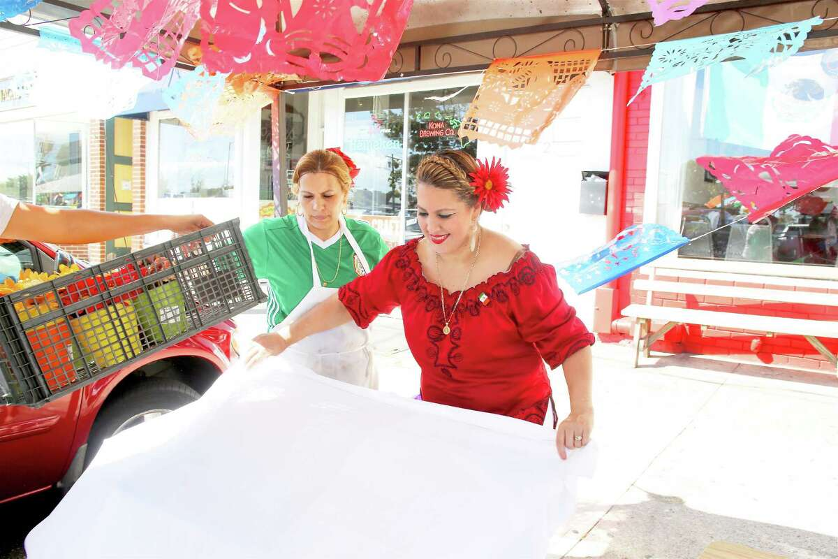 Griselda Loza decorates in preparation for a Mexican Independence Day celebration at Los Molcajetes restaurant in Norwalk September 16, 2016.