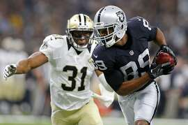 FILE - In this Sunday, Sept. 11, 2016, file photo, Oakland Raiders wide receiver Amari Cooper (89) pulls in a pass reception in front of New Orleans Saints free safety Jairus Byrd (31) in the first half of an NFL football game in New Orleans. When Amari Cooper arrived at Alabama back in 2012, he immediately started studying film of an old Crimson Tide receiver he wanted to emulate. Cooper took those lessons from watching Julio Jones and ended up breaking all the major career receiving records at Alabama and following him into the NFL as a first-round draft pick. Now Cooper gets to share a field with Jones when the Oakland Raiders (1-0) host the Atlanta Falcons (0-1) on Sunday. (AP Photo/Butch Dill, File)