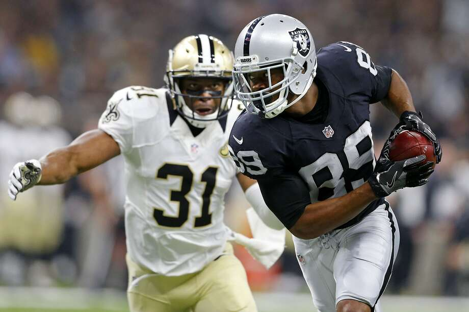 FILE - In this Sunday, Sept. 11, 2016, file photo, Oakland Raiders wide receiver Amari Cooper (89) pulls in a pass reception in front of New Orleans Saints free safety Jairus Byrd (31) in the first half of an NFL football game in New Orleans. When Amari Cooper arrived at Alabama back in 2012, he immediately started studying film of an old Crimson Tide receiver he wanted to emulate. Cooper took those lessons from watching Julio Jones and ended up breaking all the major career receiving records at Alabama and following him into the NFL as a first-round draft pick. Now Cooper gets to share a field with Jones when the Oakland Raiders (1-0) host the Atlanta Falcons (0-1) on Sunday. (AP Photo/Butch Dill, File) Photo: Butch Dill, Associated Press