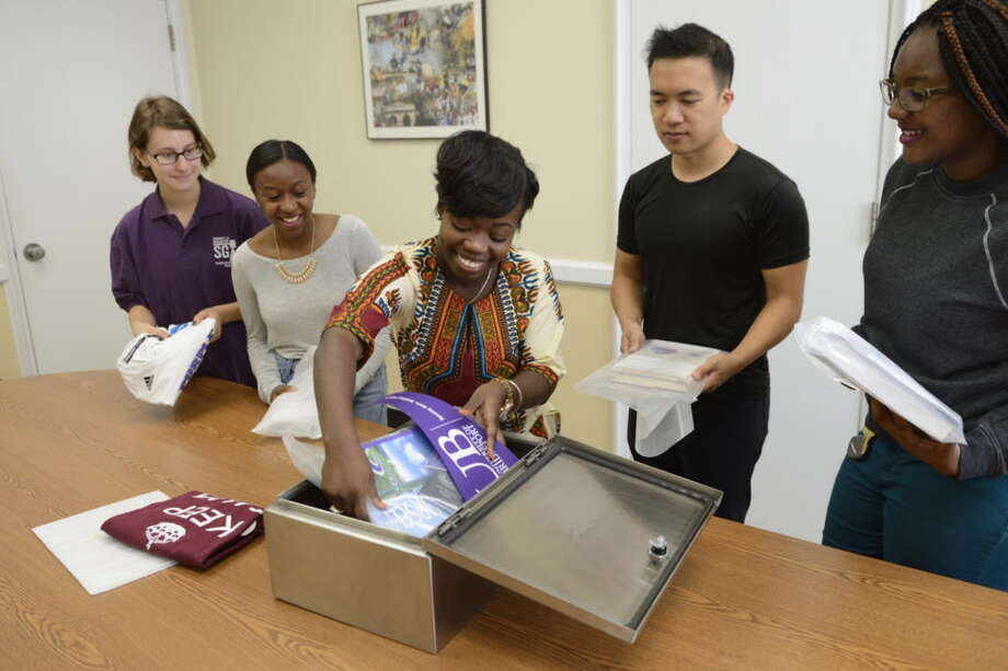 UB students helping to install the time capsule. Photo: Contributed By University Of Bridgeport / Contributed