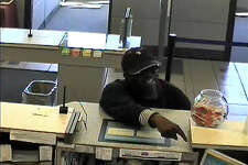 Surveillance photos of the suspect in a robbery of the Webster Bank on Connecticut Ave. in Norwalk in August.