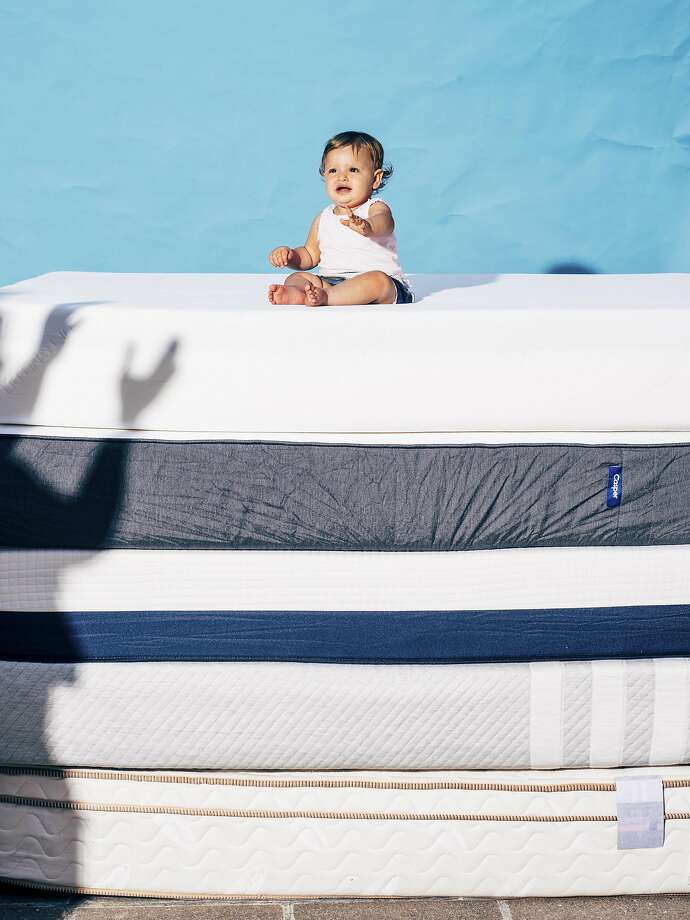 A baby sits atop mattresses from several companies that were the subjects of in-home trials. Many Web mattress retailers vow they'll take the product back if it flunks a comfy-sleep test. Photo: COLE WILSON, NYYT