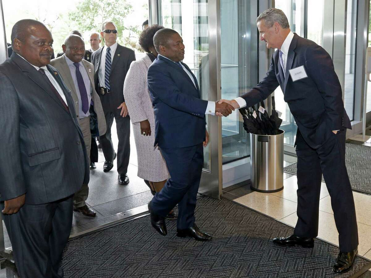 Al Walker, right, Anadarko Petroleum Corp. CEO, greets Filipe Nyusi, the President of Mozambique, and the First Lady of Mozambique, Isaura Ferra Nyusi, as they arrive at Anadarko's Allison Tower, 1201 Lake Robbins Dr., Friday, Sept. 16, 2016, in The Woodlands. ( Melissa Phillip / Houston Chronicle )