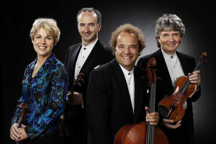 The celebrated Tak�cs Quartet -- from left to right, violist Geraldine Walther, violinist Edward Dusinberre, cellist Andr�s Fej�r and violinist K�roly Schranz -- comes to UC Berkeley's Cal Performances Oct. 15 for the first of three residences delving into the complete Beethoven string quartets. Photo: Courtesy Tak�cs Quartet, Stephen Collector