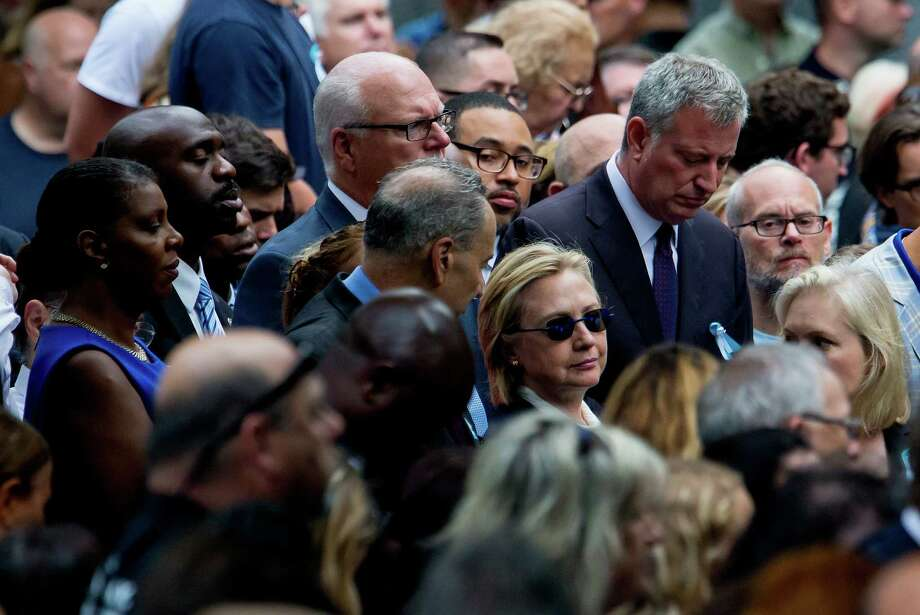 Democratic presidential candidate Hillary Clinton abruptly left a 9/11 commemoration ceremony, and a video appeared to show her struggling to maintain her balance as Secret Service agents lifted her into a van. Her physician said the incident was related to pneumonia and dehydration. Photo: ERIC THAYER /NYT / NYTNS