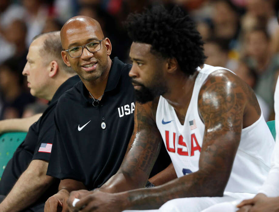 United States assistant coach Monty Williams, left, talks with DeAndre Jordan right, during a basketball game against Serbia at the 2016 Summer Olympics in Rio de Janeiro, Brazil, Friday, Aug. 12, 2016. Photo: Eric Gay /Associated Press