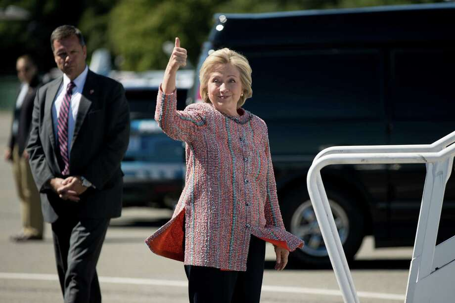 Democratic presidential candidate Hillary Clinton gives a thumbs up as she arrives to board her campaign plane on Thursday. Clinton returned to the campaign trail after a bout of pneumonia that sidelined her for three days and revived questions about both Donald Trump's and her openness regarding their health. Photo: Andrew Harnik /Associated Press / Copyright 2016 The Associated Press. All rights reserved.