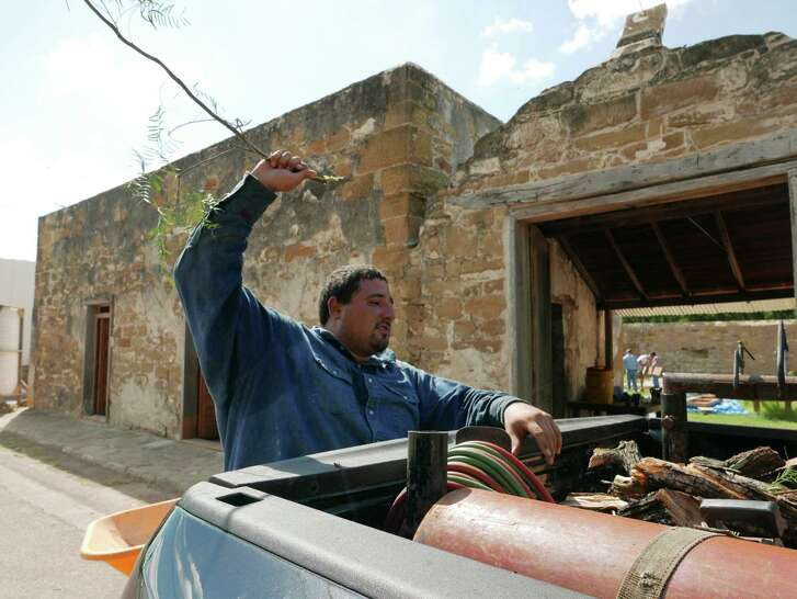 Jose Orlando Villarreal, whose family has lived for seven generations in San Ygnacio, Texas, works on the Trevi–o-Uribe Ranch, whose first structure was built in 1830. It is now being restored by local artisans. Wednesday, Sept. 15, 2016.