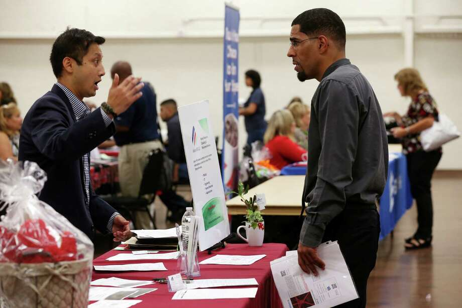 Alamo Human Resource's Nick Thu (left) talks with Melvin Washington during the Leon Valley Employer Symposium and Job Fair this week. The state is on track to see its strongest job growth in nearly two years during the second half of 2016. Photo: Photos By Jerry Lara /San Antonio Express-News / © 2016 San Antonio Express-News