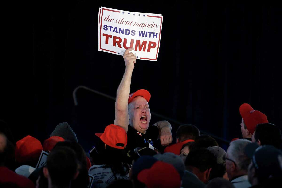 A supporter of Republican presidential candidate Donald Trump displays a placard during a Trump campaign rally in April in Warwick, R.I.