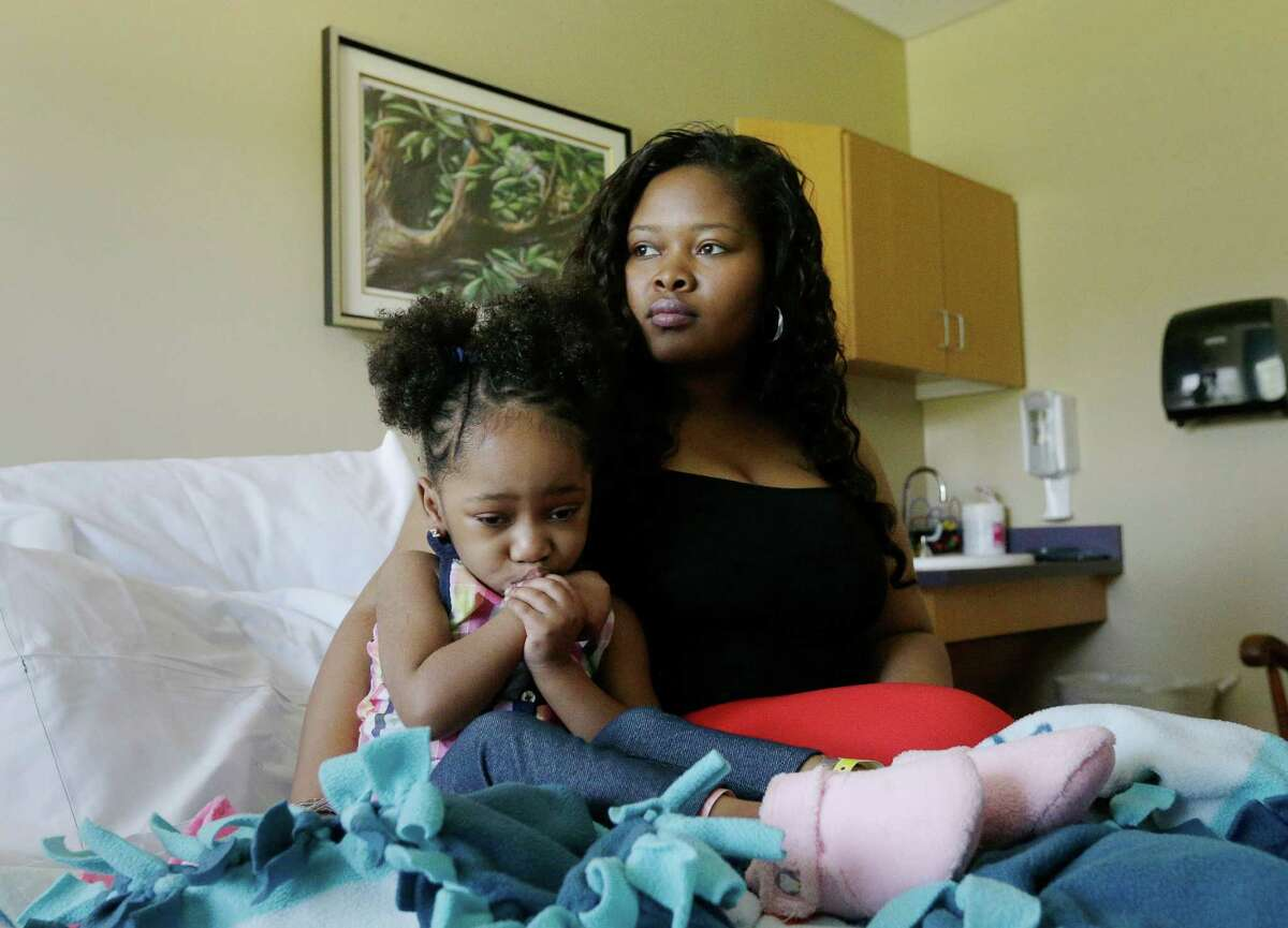 Courissa Hall, right, poses for a portrait with her daughter Nevaeh, 4, at a specialty and rehabilitation hospital in west Houston Thursday, April 7, 2016, in Houston. Nevaeh suffered brain damage during a dental procedure. (Photo: Jon Shapley / Houston Chronicle )