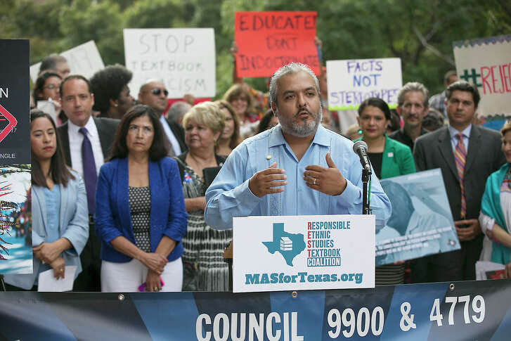 "State Board of Education member Ruben Cortez Jr. joins Mexican-American advocates and activists at a rally opposing the textbook ""Mexican American Heritage"" on Tuesday in Austin. (Ralph Barrera / Austin American-Statesman)"