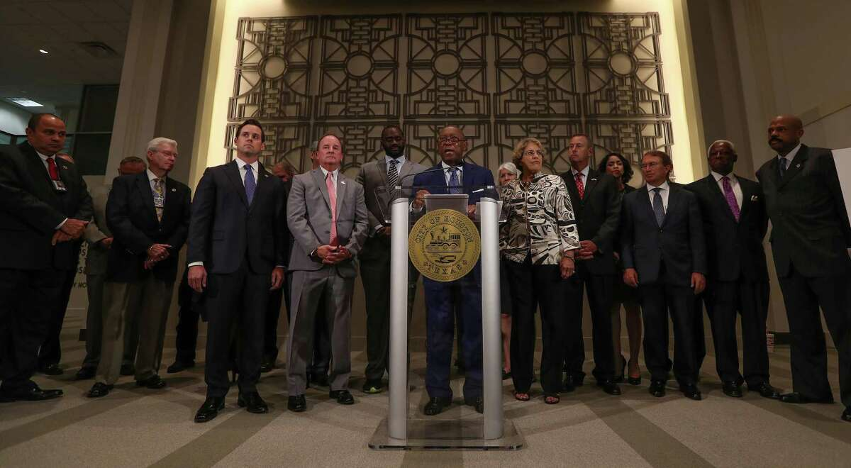 Representatives from the police and municipal employee pension boards joined city officials for the announcement of a tentative pension reform deal, but they did not comment on theplan. The fire pension board did not attend. ( Steve Gonzales / Houston Chronicle )