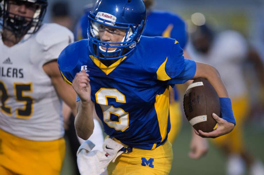 Midland High's quarterback Cade Methner rushes for yards in the first half of Midland's home game against Mount Pleasant Friday evening. Photo: Brittney Lohmiller/Midland Daily News/Brittney Lohmiller, Brittney Lohmiller/Midland Daily News