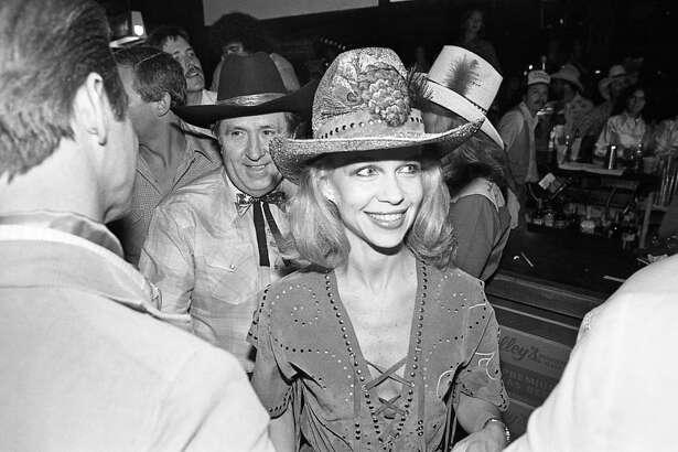 """06/05/1980 - Oscar and Lynn Wyatt at Houston movie premiere party for """"Urban Cowboy"""" at Gilley's club."""