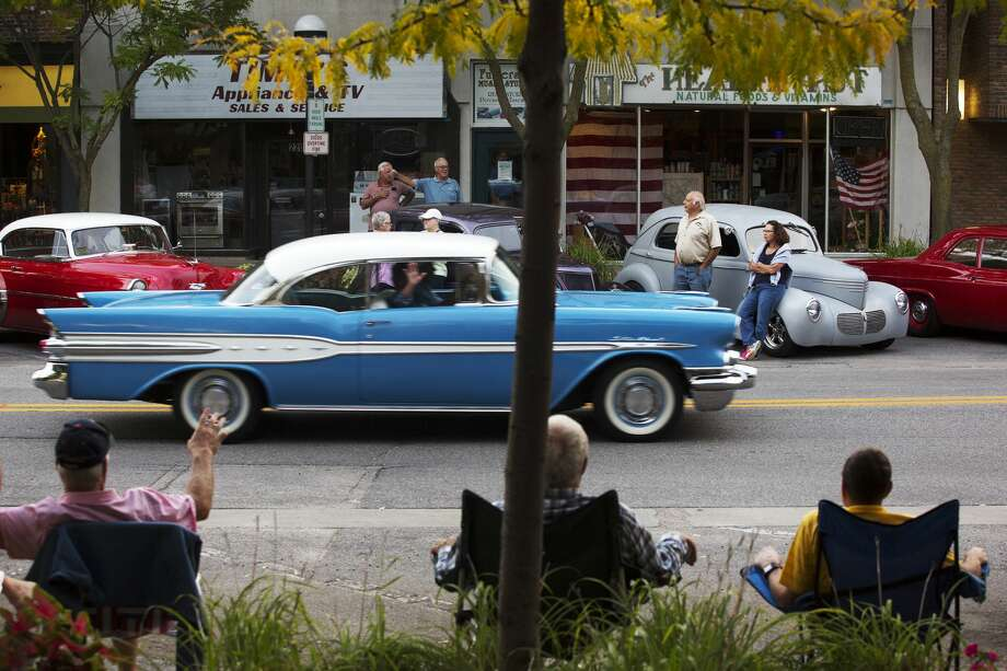 Vehicles cruise Main Street while participating in the Cruisin' Car Show in Downtown Midland on Friday. Photo: Theophil Syslo, Theophil Syslo/Midland Daily News