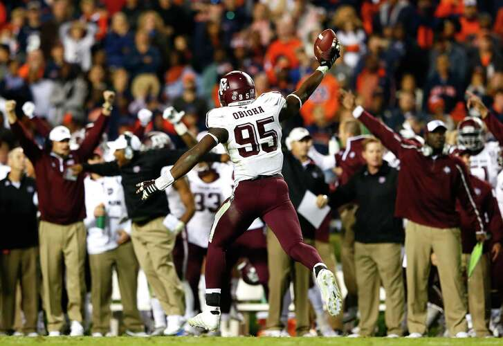 Julien Obioha #95 of the Texas A&M Aggies reacts after recovering a fumble by the Auburn Tigers on their two-yard line in just under the last three minutes of their 41-38 win at Jordan Hare Stadium on November 8, 2014 in Auburn, Alabama.  (Photo by Kevin C. Cox/Getty Images)