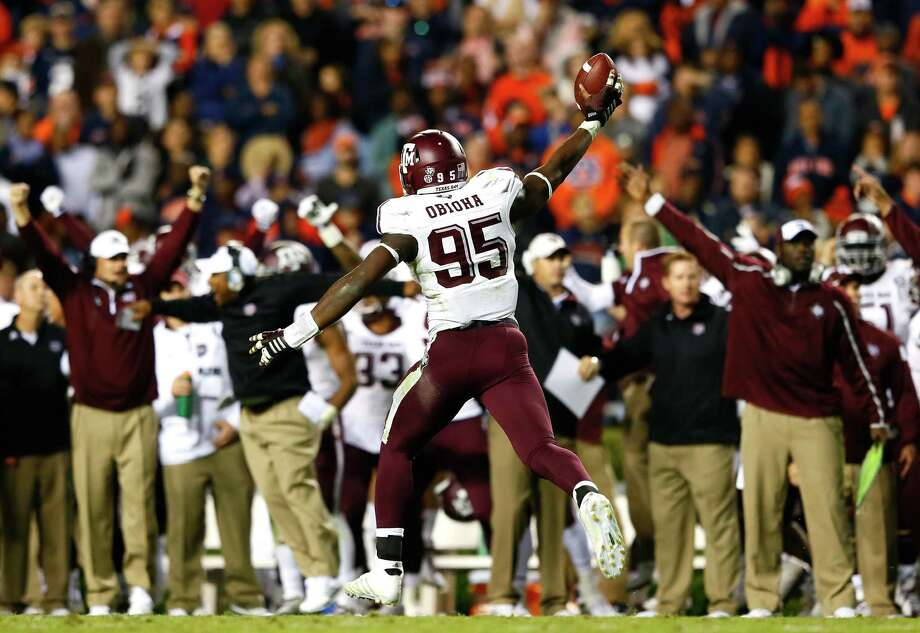 Julien Obioha #95 of the Texas A&M Aggies reacts after recovering a fumble by the Auburn Tigers on their two-yard line in just under the last three minutes of their 41-38 win at Jordan Hare Stadium on November 8, 2014 in Auburn, Alabama.  (Photo by Kevin C. Cox/Getty Images) Photo: Kevin C. Cox, Staff / Getty Images / 2014 Getty Images