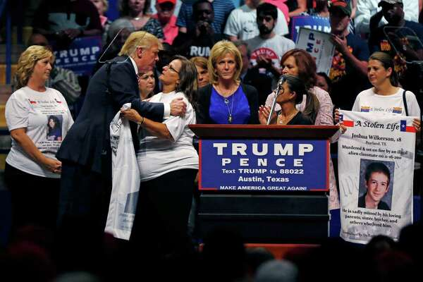 Republican presidential candidate Donald Trump embraced supporters of the Remembrance Project who have lost children to violence by undocumented immigrants at a campaign rally last month in Austin.
