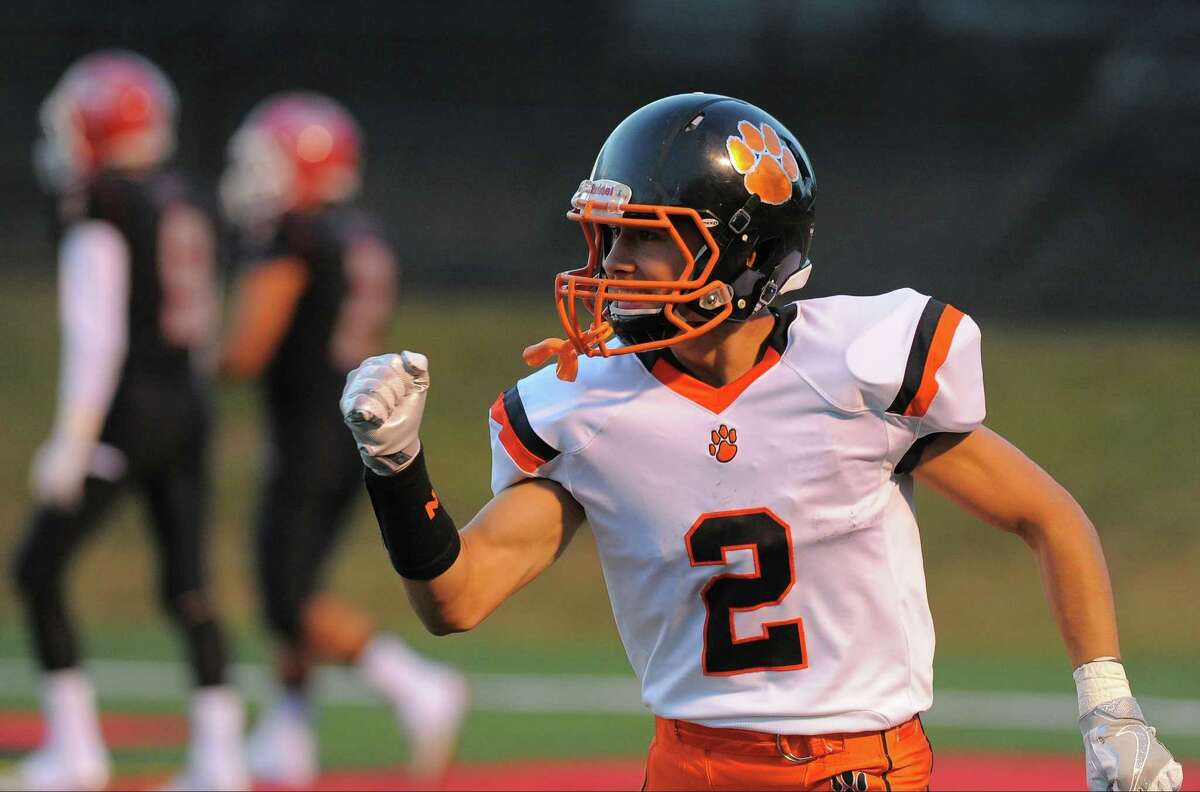 Ridgefield Shane Palmer pumps his fist following a first quarter touchdown against New Canaan in a boys varsity football game at New Canaan High School in New Canaan, Conn. on Friday, Sept.16, 2016.
