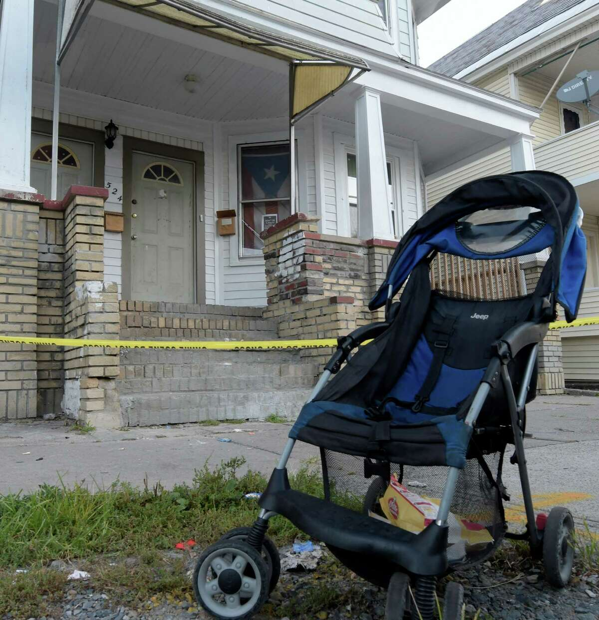 Schenectady Police police line tape keeps the scene secure at 524 Schenectady Street Friday Sept. 16, 2016 in Schenectady, N.Y. the scene of the murder of a 17 year old mother of one child. (Skip Dickstein/Times Union)