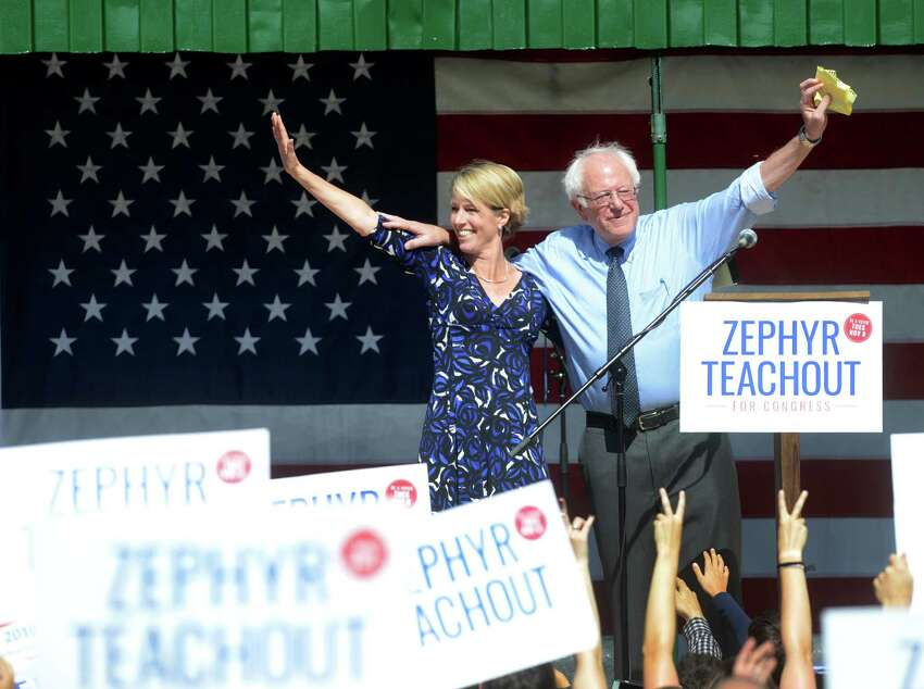 Democratic Congressional candidate Zephyr Teachout, left, and U.S. Sen. Bernie Sanders, I-Vt. wave to the crowd at Hasbrouck Park during a campaign rally, Friday, Sept. 16, 2016, in New Paltz, N.Y. Teachout is running against Republican John Faso for a seat Democrats see as a prime pick-up opportunity. (Tania Barricklo /The Daily Freeman via AP)