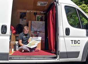 Mikah Meyer checks his road map at the Saratoga National Historical Park Friday Sept. 16, 2016 in Stillwater,NY. Living out of a van, Meyer is visiting all 413 National Parks over the next few years.   (John Carl D'Annibale / Times Union)