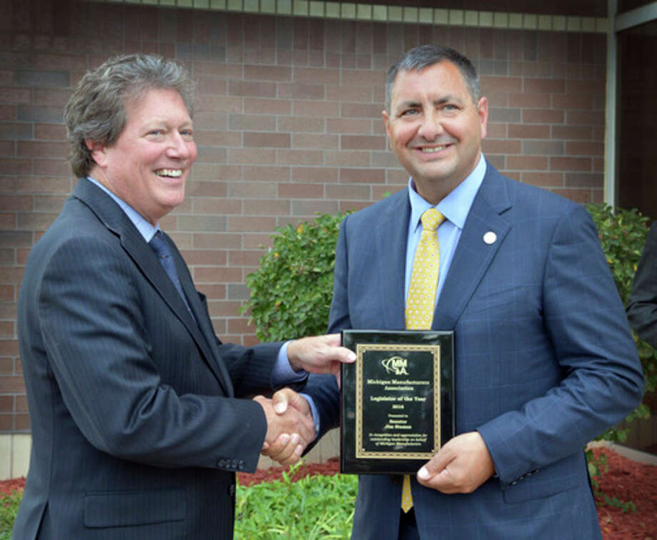 State Sen. Jim Stamas, R-Midland, right, received the 2016 Legislator of the Year from the Michigan Manufacturers Association in Lansing.MMA President and CEO Chuck Hadden presented Stamas with the award in recognition of Stamas' leadership and support of Michigan manufacturers throughout the state.