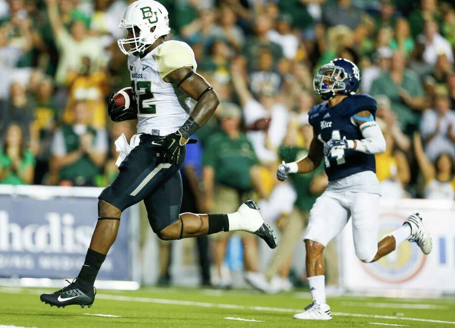 Baylor running back Terence Williams (22) runs past Rice cornerback J.T. Blasingame (14) on his way to a 24-yard touchdown run during the second quarter of an NCAA football game at Rice Stadium on Friday, Sept. 16, 2016, in Houston. Photo: Brett Coomer, Houston Chronicle / © 2016 Houston Chronicle