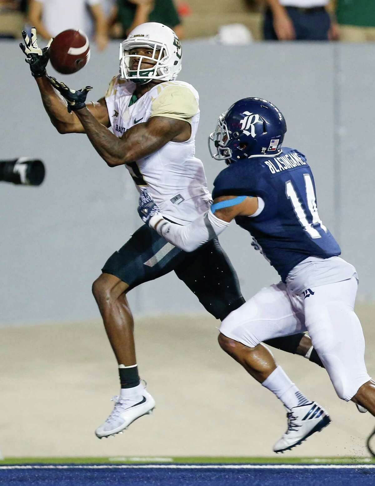 Baylor wide receiver KD Cannon (9) beats Rice cornerback J.T. Blasingame (14) for a 10-yard touchdown reception during the second quarter of an NCAA football game at Rice Stadium on Friday, Sept. 16, 2016, in Houston.