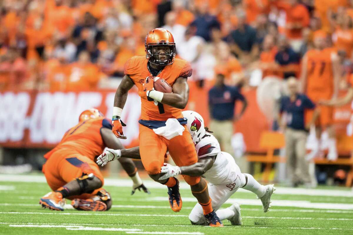 SYRACUSE, NY - SEPTEMBER 09: Dontae Strickland #4 of the Syracuse Orange is tackled by Trumaine Washington #15 of the Louisville Cardinals during the second quarter on September 9, 2016 at The Carrier Dome in Syracuse, New York. (Photo by Brett Carlsen/Getty Images) ORG XMIT: 660235189